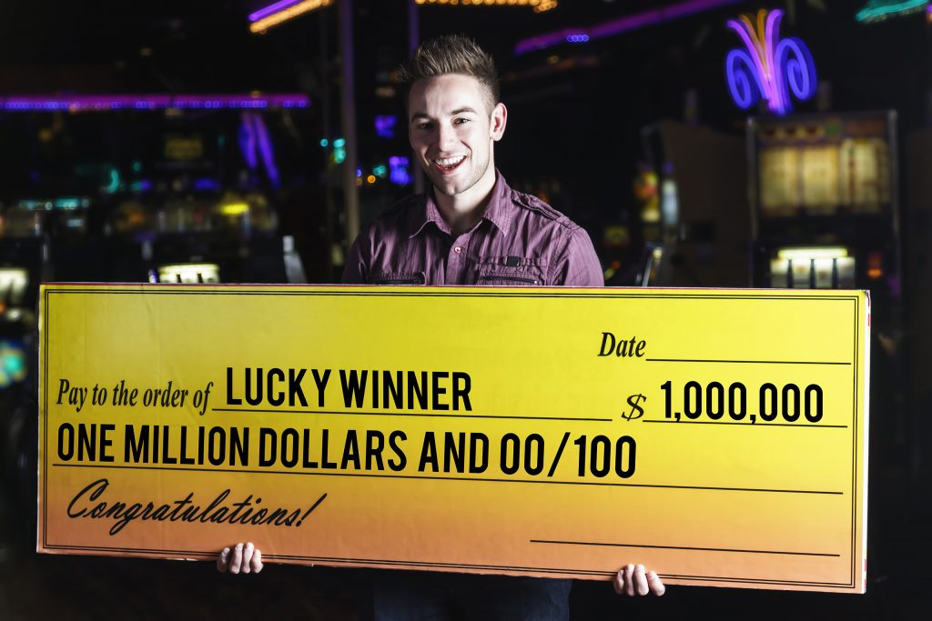 Happy Man Holding Giant Check In a Casino